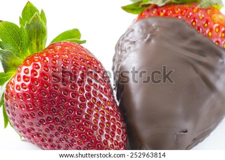 Dark chocolate dipped a strawberry on a white background. - stock photo