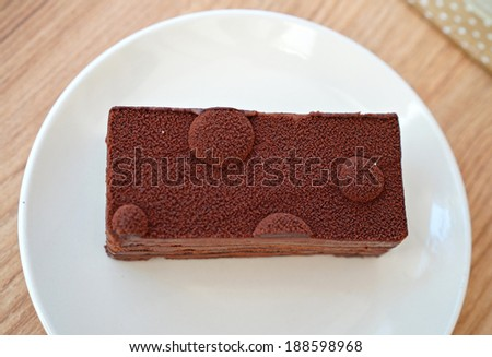 Dark Chocolate Mousse on white plate. - stock photo