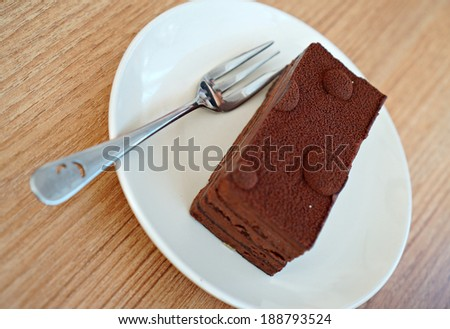 Dark Chocolate Mousse on white plate with fork.  - stock photo