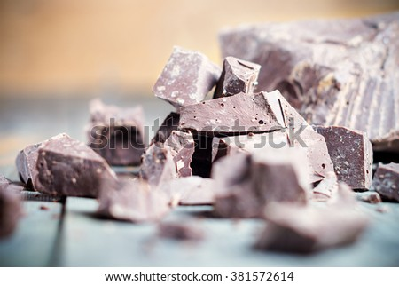 Dark chocolate pieces , chocolate candy, cocoa. Shallow DOF. With toning - stock photo
