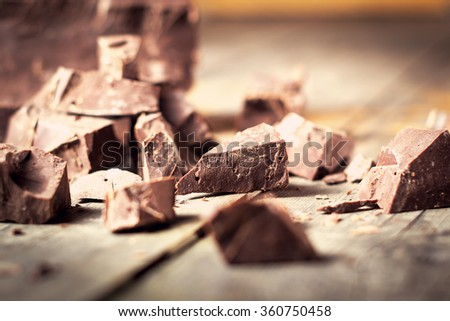 Dark chocolate pieces , chocolate candy, cocoa. With toning . Shallow DOF - stock photo