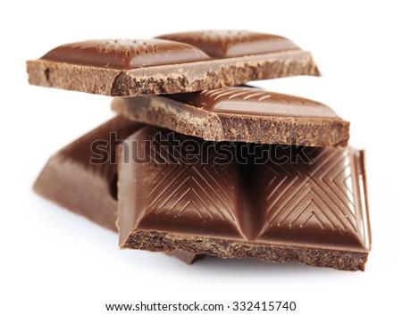 Dark chocolate pieces isolated on white - stock photo