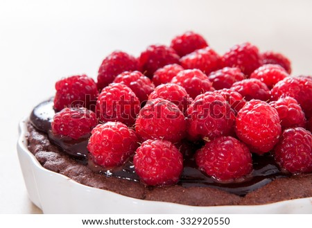 Dark chocolate raspberry tart / pie / cake
