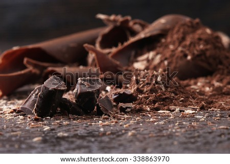 Dark chocolate shavings and sprinkled cocoa powder - stock photo