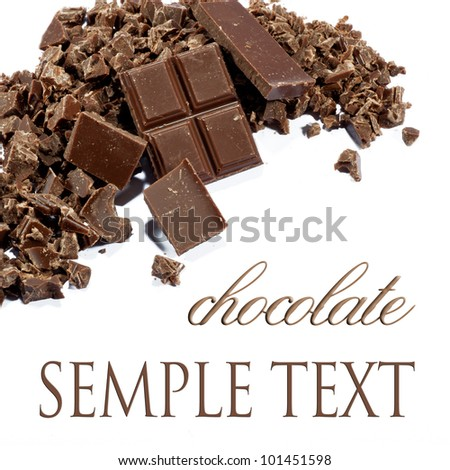 Dark chocolate shavings on a white background