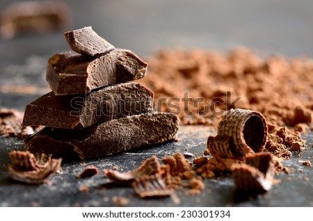 Dark chocolate stack, chips and powder - stock photo
