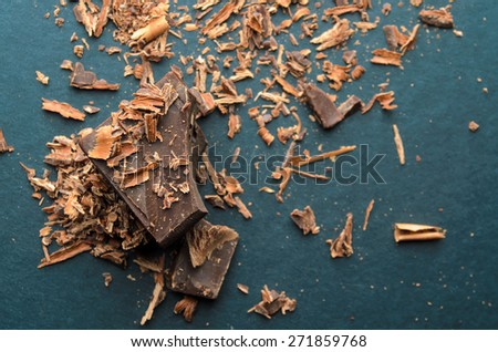 Dark chocolate stack, chips and powder. Shallow depth of field. - stock photo