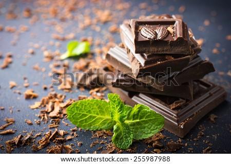 Dark chocolate with mint leaf - stock photo