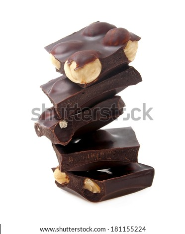 Dark chocolate with nuts on a white background, closeup - stock photo