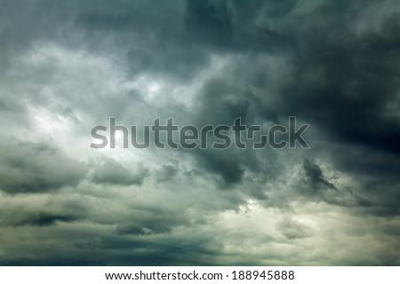 Dark clouds across the sky before heavy rain - stock photo