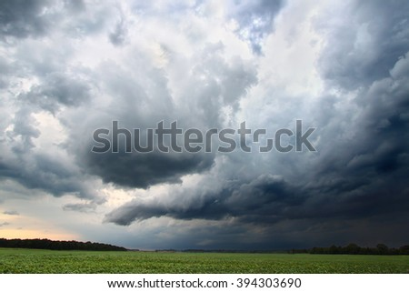 Dark clouds and turbulent skies accompany a strong thunderstorm in Indiana. - stock photo