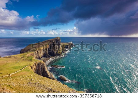 Dark clouds at Neist Point Lighthouse minutes before a heavy strom on the Isle of Skye - Scotland, UK - stock photo