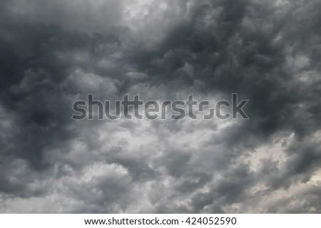 Dark clouds before thunderstorm rain - stock photo