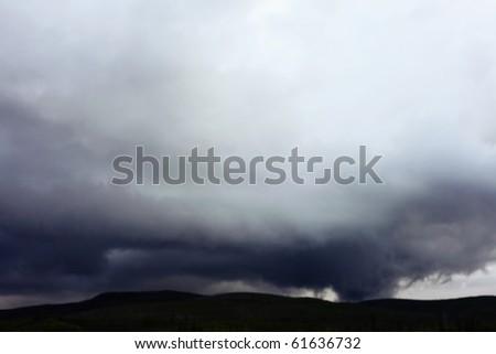 Dark clouds brewing before rain. - stock photo