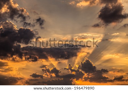 dark clouds in sunset with sun rays