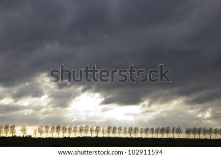 Dark clouds preceding an approaching storm, Holland - stock photo