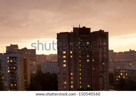 dark cloudy sunset in city before storm - stock photo