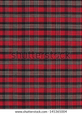 Dark colored red black and white plaid gingham fabric swatch textile background. - stock photo