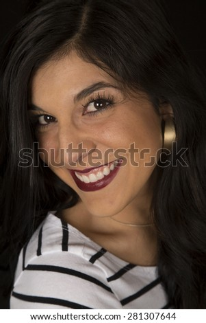 Dark complected female portrait smiling striped top