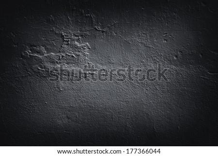 Dark concrete floor texture, great for grunge backgrounds. - stock photo