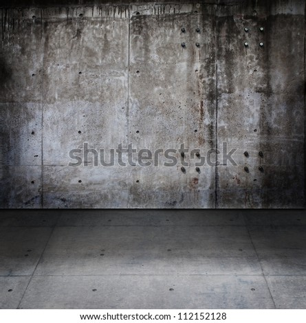 Dark concrete room with wall and floor.