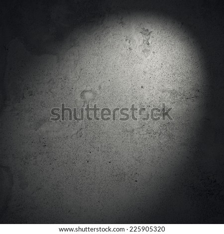 Dark concrete wall with spotlight - stock photo