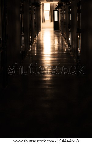 Dark corridor and light at window
