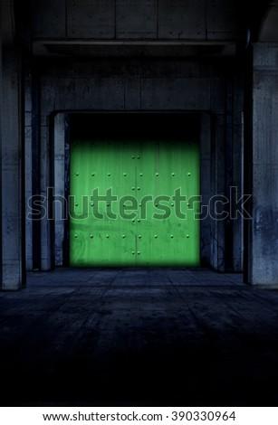 Dark corridor made with green metal door. Concrete floor and columns. dark and dim facility hall.  - stock photo