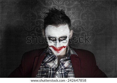 Dark creepy joker face - stock photo