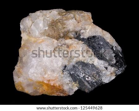 Dark crystals of wolframite (tungsten ore) in quartz - stock photo