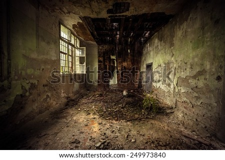 Dark damaged room interior with bad rooftop - stock photo