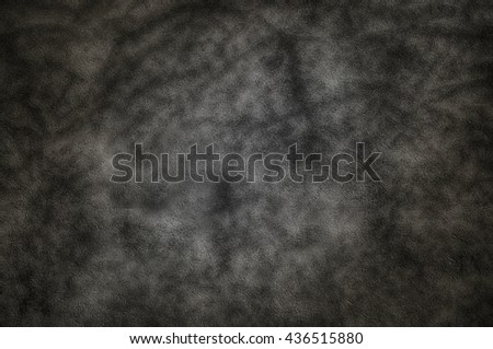 Dark deep gray wall with shadow pattern as background. - stock photo
