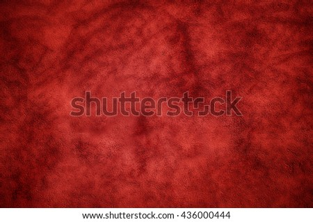 Dark deep red wall with shadow pattern as background. - stock photo