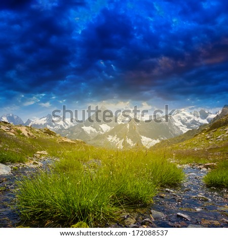 dark dense clouds above a mountain valley