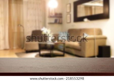dark desk and interior of sofa  - stock photo