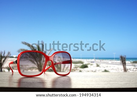 dark desk and suglasses  - stock photo