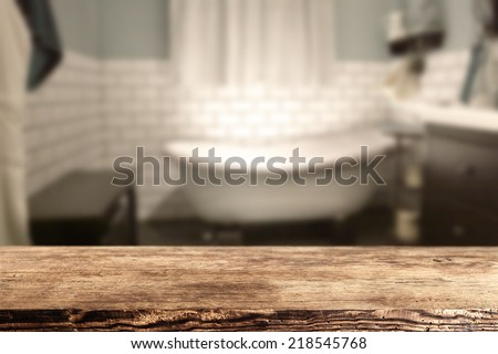 dark desk of free space and white bath in bathroom  - stock photo