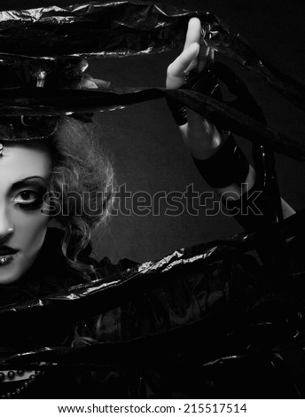 Dark Doll. Young woman in holiday image of mystery gothic doll. - stock photo