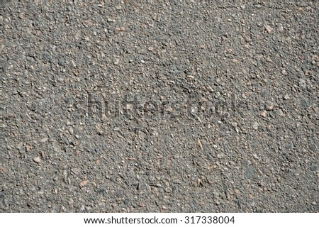 Dark dry detailed strength asphalted grungy structure surface background. View close-up with space for text on empty clean leaden context field - stock photo