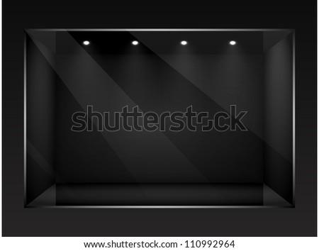 Dark empty show window of shop. - stock photo