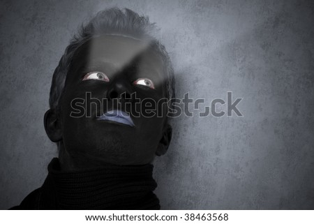 Dark face portrait with lighting eyes - stock photo