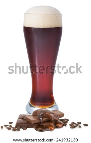 Dark filtered beer with foam in the glass on a white background with barley,unfiltered and caramel - stock photo