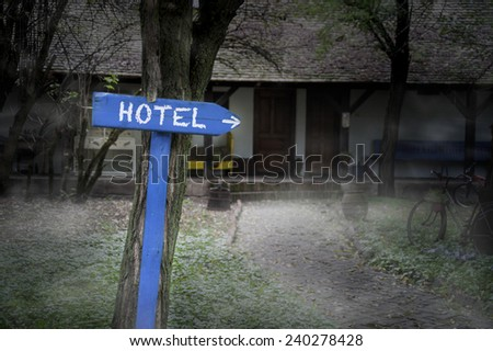 Dark Foggy Hotel Sign - stock photo