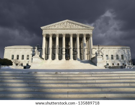 Dark forbidding troubled storm sky over the United States Supreme Court building in Washington DC. - stock photo