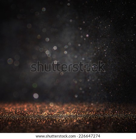dark glitter vintage lights background. light gold and black. defocused.  - stock photo