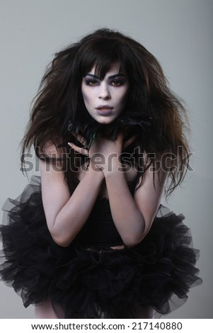 Dark Gothic Expressive Woman on Plain Background - stock photo