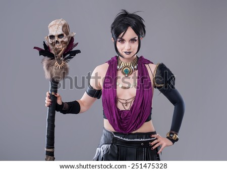 Dark gothic woman. Sexy gothic woman posing with skull.