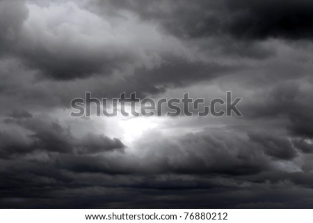 Dark gray clouds in dramatic stormy sky