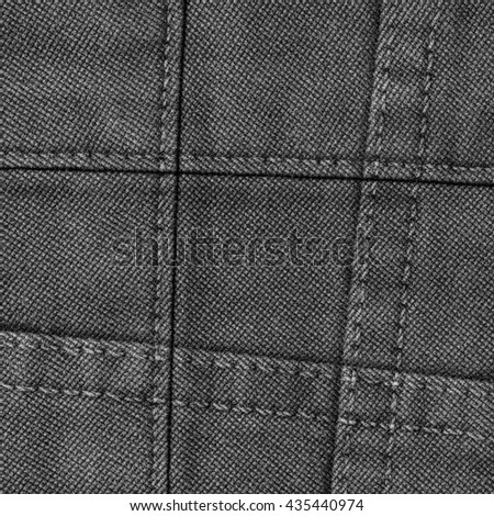 dark gray denim texture decorated with seams