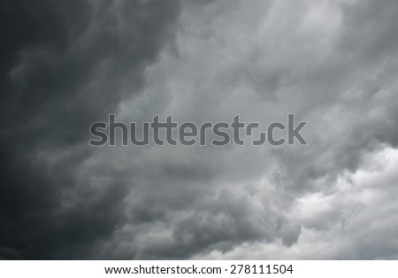 dark gray dramatic sky with large clouds - stock photo